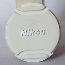 White Nikon LC-N40.5 40.5mm edge pinch front lens cap.