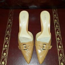 Brand new UNISA heeled camel leather mules with buckle details.  Size 7 B.