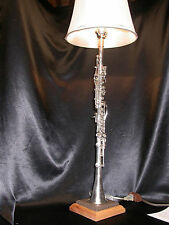 CAVALIER METAL CLARINET LAMP ON BROWN MOTTLED CORIAN & NATURAL OAK BASE