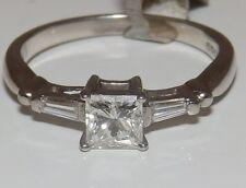 A FINE  PLATINUM   0.6CT PRINCESS & BAGUETTE CUT  DIAMOND 3 STONE  RING