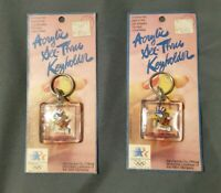 Lot of 2 Vtg 1984 LOS ANGELES OLYMPICS Square Keychain Acrylic SAM THE EAGLE NIP