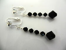 A PAIR OF DANGLY BLACK GLASS CRYSTAL SILVER PLATED CLIP ON   EARRINGS.