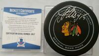 BECKETT COA ARTEM ANISIMOV SIGNED CHICAGO BLACKHAWKS OFFICIAL GAME PUCK BETTMAN