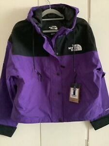 Women's north face jacket new with tags 'Reign on ' in size large purple &black