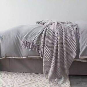 Brand new soft knitted tassle grey throw