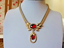 Brand new necklace with a gold and silver double strand chain and red crystals
