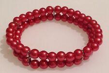 bracelet  sur 2 rangées de perles porcelaine rose  244
