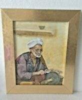 A totally original signed framed watercolour painting of old man sharpening