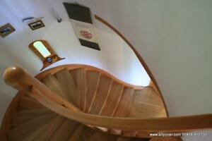 Siberian larch helical custom made staircase production.