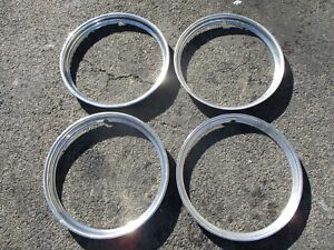 Lot of 4 1946 Dodge Chrysler Plymouth Ford 16 inch beauty rings trim rings