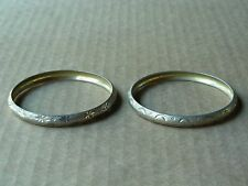 PAIR OF GOLD-TONE ETCHED BANGLE BRACELETS