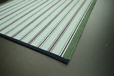 Striped flat weave wool rug edged in navy blue cotton tape
