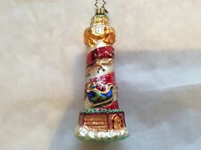 """Radko """"Seaside Delivery�Lighthouse With Santa Circling On A Sleigh"""
