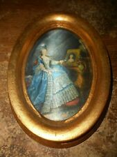 """7"""" oval wood framed picture"""