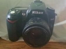 nikon d90 camera, two lenses, battery pack with charger, protective travel case