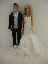 A Set of 2 an Elegant Bright White Wedding Gown with Veil and a Black Tux Made f