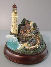 "Hawthorne Village Thomas Kinkade's ""The Light of Peace"" Light-Up Lighthouse Fig."