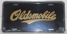 OLDSMOBILE ALUMINUM LICENSE PLATE WITH OLDS LOGO BLACK AND GOLD MADE IN USA GM