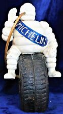 MICHELIN MAN ON TYRE CAST IRON ORNAMENT