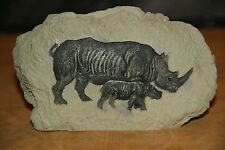MAMA RHINOCEROS & BABY CARVED INTO WHAT LOOKS LIKE A ROCK (RESIN)