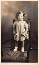 Young girl standing on chair 'Swift Studios' 37 Frankfort Street, Pymouth  qq26