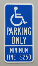 Handicap parking sign with minimum fine $250 (Reflective by lighting)