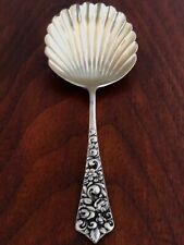 - RAND & CRANE STERLING SILVER TEA CADDY SPOON: SHELL BOWL, ROSES TO HANDLE