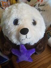 the petting zoo plush ball otter with purple starfish