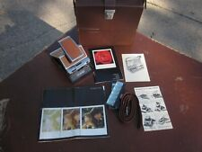 VINTAGE POLAROID SX-70 LAND CAMERA with CASE, INSTRUCTIONS AND PARTIAL FLASH BAR