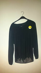 LONG SLEEVED DRESSY BLACK TOP WITH TIE COLLAR