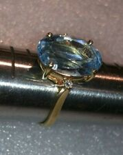 14k gold ring with aquamarine and diamond accents