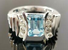 Beautiful Modern Blue Topaz Round Diamond Tension 14k white gold ring