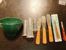 Dental lab supplies (mixing bowl, spatulas, knives, rubber trays)