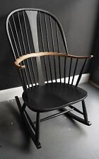 A vintage 1970s Black Ercol Chairmakers rocking chair