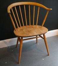 A vintage 1960s Ercol 'cowhorn' windsor chair