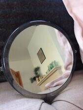Round vanity mirror ideal for applying make-up or shaving, magnifier on one side