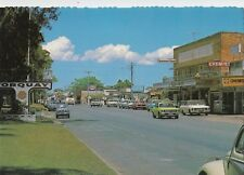 Postcard Harvey Bay Torquay 1960's showing main street, cars etc text at back