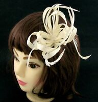 Hair fascinator in a twisted cream sinamay, for weddings, races and occasions