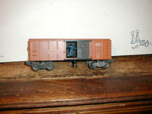 Lionel Postwar #3464 AT&SF Operating Boxcar in brown