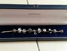 Silver Rhona Sutton charm bracelet and 9 silver charms . Lovely bracelet