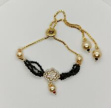 Delicate and adjustable bracelet gold plated with black/ beads