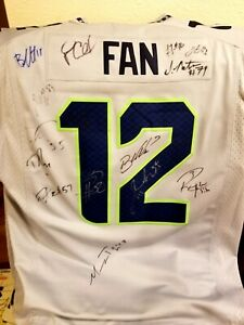 Elite Seahawks autographed Jersey- Russell wilson, Pete Carroll and many more!