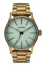 Nixon Sentry 38 SS Watch (All Brass / Green Crystal)