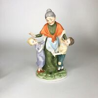 "Ceramic grandmother and grandkids statue 9""x5.5"""