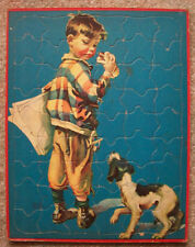 Newspaper boy eating hotdog being watched by dog vintage tray puzzle Hunter