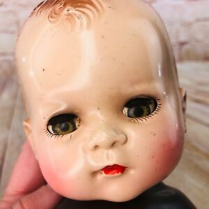 antique composition head and soft rubber dark skinned body sleepy eyes usa made