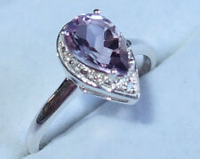 Pale Amethyst solitaire (1.250ct) with White Topaz, in Sterling Silver. Size O.