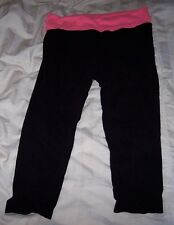yoga pants,black with pink waist band,pre-owned,juniors Lrg,exercise,casual