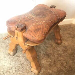 Vintage Camel Saddle Ottoman Hand Tooled Geometric Leather Carved Wood Leg Motif