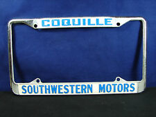 COQUILLE SOUTHWESTERN Motors Dealer Embossed Metal License Plate Frame Oversized